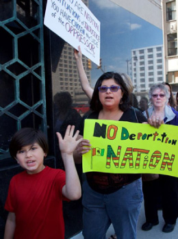 No Deportation mom and son protesting