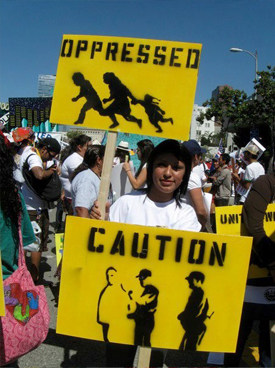Caution Oppressed signs at protest